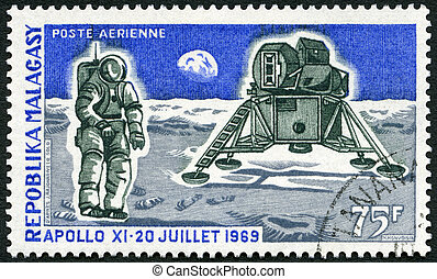 MALAGASY REPUBLIC - 1969: shows Apollo 11 Lunar Landing Module and Man on the Moon, first anniversary of man's first landing on the moon