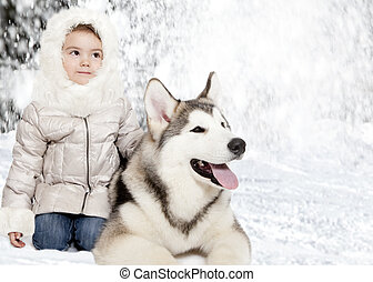 Malamute puppy with a little girl