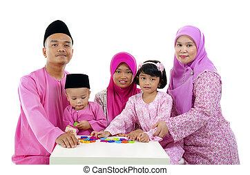 malay family during hari raya aidilfitri having fun with...