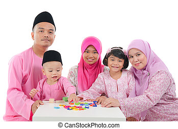 malay family during hari raya - malay family playing and...