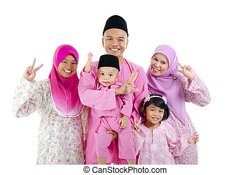 malay family in traditional malay clothing