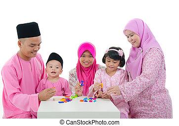 malay family playing and having quality time during hari raya