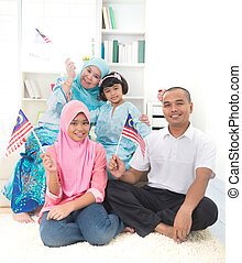 malay family with malaysian flag lifestyle photo