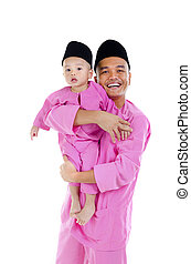 malay father and son during hari raya