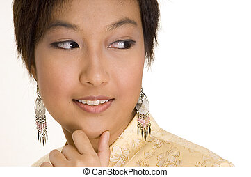 Malay Girl 16 - A pretty young asian woman in a yellow silk...