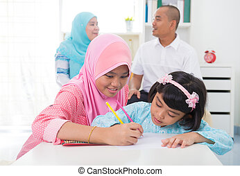 malay indonesia Muslim family colouring at home.