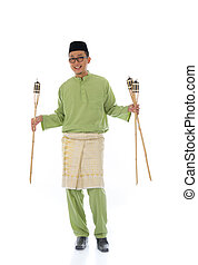 Malay male celebrating hari raya with oil lamp and isolated white background