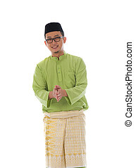 Malay male greetings during hari raya with isolated white...