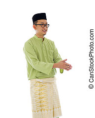 Malay male greetings during ramadan festival with isolated white background