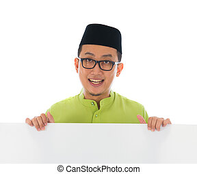 malay male with blank card during hari raya Eid al-Fitr aidilfit