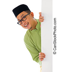 malay male with blank card during hari raya Eid al-Fitr aidilfitri celebration