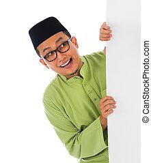 malay male with blank card during hari raya Eid al-Fitr celebration