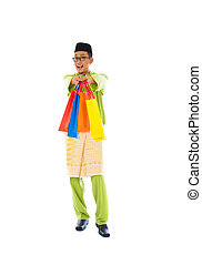 malay male with shopping bags during festival season