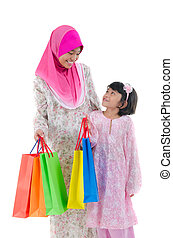 Malay sisters during raya shopping festival