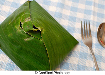 Malay traditional food in banana leaf - Malay traditional...