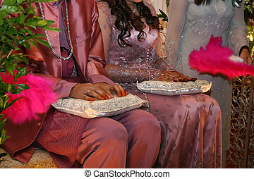 Malay Wedding Ceremony held in Malaysia, which is known as...