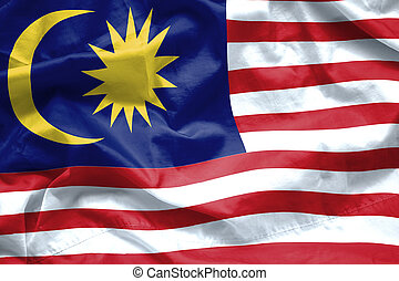 Malaysia Flag background. Closeup of ruffled Malaysia flag blowing in the wind