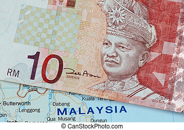 Malaysian currency with map of malaysia background