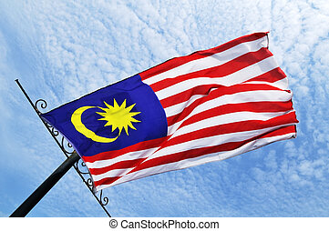 Malaysian flag flying - Malaysian flag blowing in the wind...