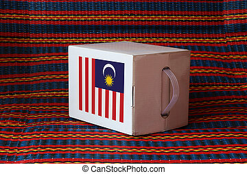 Malaysian flag on white box with stripe background, Paper packaging for put products. The concept of Malaysia export trading.