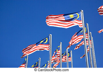 Image of Malaysian flags, also known as Jalur Gemilang, flying high.