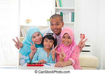 malaysian malay muslim family learning together with lifestyle b