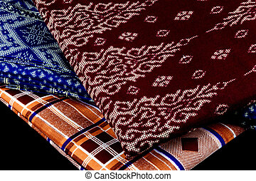 Malaysian Sarongs on a Black Background