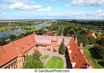 Malbork castle in Pomerania region of Poland. UNESCO World Heritage Site. Teutonic Knights' fortress also known as Marienburg - aerial view.