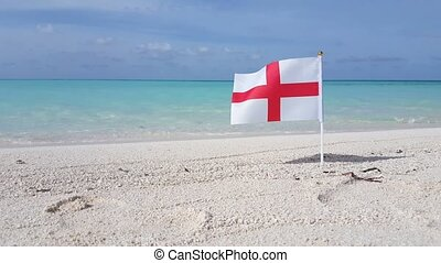 Maldives beautiful beach background white sandy tropical paradise island with blue sky sea water ocean 4k england english red cross st george flag