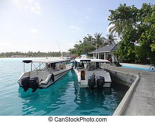 Maldives. boats on water.