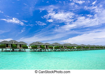 Maldives buildings in water - A row of buildings built over ...