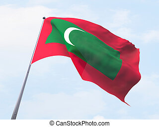 Maldives flag flying on clear sky.