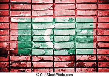 Maldives Flag painted on grunge wall