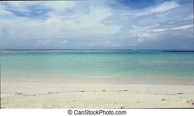 Maldives, Indian Ocean. Gorgeous view of tropical landscape . White sand and light turquoise water with blue sky and white clouds. Time lapse