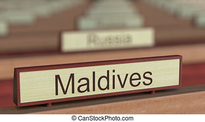 Maldives name sign among different countries plaques at...