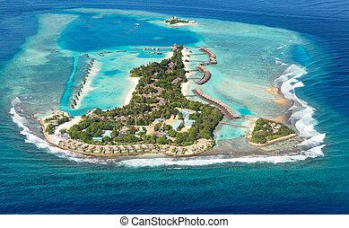 Maldives sea island from air