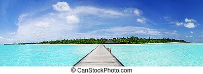 Maldives - Tropical Maldivian paradise - a jetty leading to...