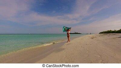 Maldives white sandy beach 1 person young beautiful lady sunbathing alone on sandbar on sunny tropical paradise island with aqua blue sky sea water ocean 4k