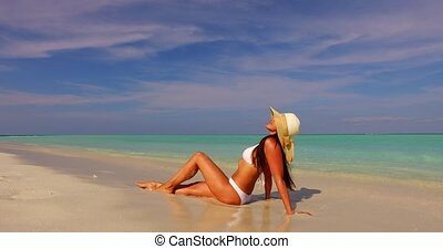Maldives white sandy beach 1 person young beautiful lady...