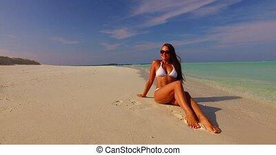 Maldives white sandy beach 1 person young beautiful lady...