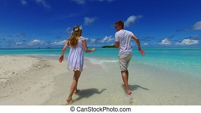 Maldives white sandy beach 2 people a young couple man woman...