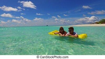 Maldives white sandy beach 2 people young couple man woman...