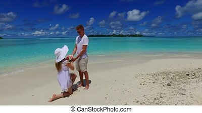 Maldives white sandy beach 2 people young couple man woman...