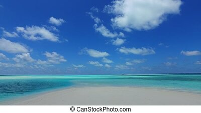 Maldives white sandy beach clouds on sunny tropical paradise...