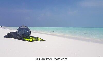 Maldives white sandy beach snorkeling fins mask flippers...