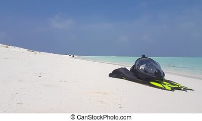 Maldives white sandy beach snorkeling fins mask flippers...