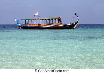Maldivian fishing boat also known as dhoni moored of an...