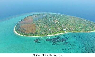 Maldivian island Thoddoo top bird's eye view. Indian Ocean.