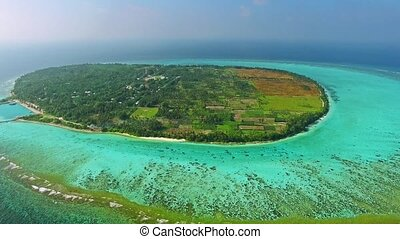 Maldivian island Thoddoo top bird's eye view. Indian Ocean.