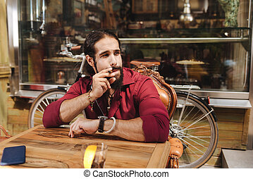 Nice handsome man smoking a cigar